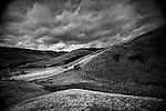 A storm brews over Edale Valley, fields, trees and desolate moor all under a menacing sky