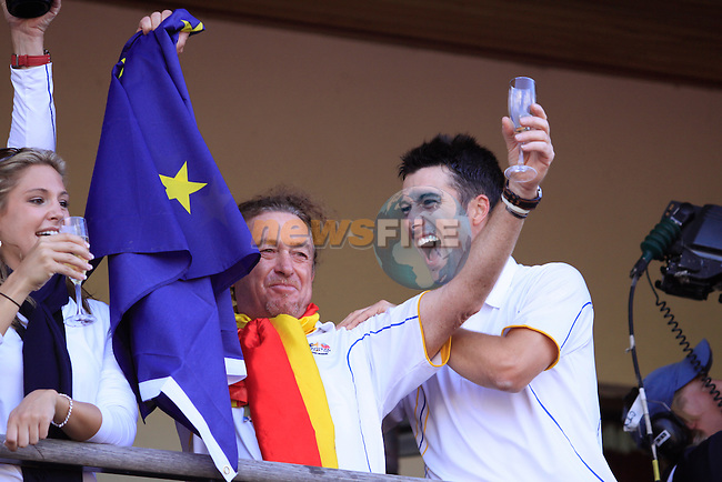 European Team Players Miguel Angel Jimenez and Ross Fisher celebrate victory on the clubhouse balcony at the end of The Final Day Monday of the 2010 Ryder Cup at the Celtic Manor Resort. (Photo Manus O'Reilly/Golffile 2010)