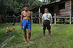 Twenty three years later: Penan natives, Baru standing with the brother of Banai Tebai. They lived twenty years ago in Long Tegan, but since the area was so thoroughly deforested, they moved upriver and now live in Long Gita. In a permanent traditional native design hardwood house on stilts. Limbang district, Sarawak, Borneo 2012<br />