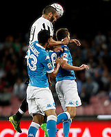Calcio, Serie A: Napoli vs Juventus. Napoli, stadio San Paolo, 26 settembre 2015. <br /> Juventus&rsquo; Giorgio Chiellini, center, and Napoli&rsquo;s Raul Albiol, left, and Jorginho jump for the ball during the Italian Serie A football match between Napoli and Juventus at Naple's San Paolo stadium, 26 September 2015.<br /> UPDATE IMAGES PRESS/Isabella Bonotto