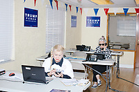 """Wearing a """"Women For Trump"""" shirt, Blanca Vrotsos, 62, of Doral, Florida, (left) has been volunteering almost everyday for 10 months at the Donald Trump campaign office in Hialeah, Miami, Florida, on Sun., Oct. 9, 2016. At rear, Zoila Oliva, 76, of Hialeah, calls potential voters. Vrotsos helps recruit volunteers, register people to vote, and train other volunteers. Originally from Cuba, she has been a US citizen for 15 years and says she is """"extremely Republican."""" She first voted in 2000 and voted for George W. Bush. She says she will always support the Republican nominee for president."""
