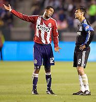 San Jose Earthquakes forward Chris Wondolowski (8) and Chivas USA defender Dario Delgado (12) have a heated exchange of words. CD Chivas USA defeated the San Jose Earthquakes 3-2 at Home Depot Center stadium in Carson, California on Saturday April 24, 2010.  .