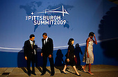Pittsburgh, PA - September 24, 2009 -- United States President Barack Obama (2L) greets Japanese Prime Minister Yukio Hatoyama (L) while welcoming him to the opening dinner for G-20 leaders as U.S. first lady Michelle Obama (R) escorts Japanese first lady Miyuki Hatayama at the Phipps Conservatory on Thursday, September 24, 2009 in Pittsburgh, Pennsylvania. Heads of state from the world's leading economic powers arrived today for the two-day G-20 summit held at the David L. Lawrence Convention Center aimed at promoting economic growth..Credit: Win McNamee / Pool via CNP