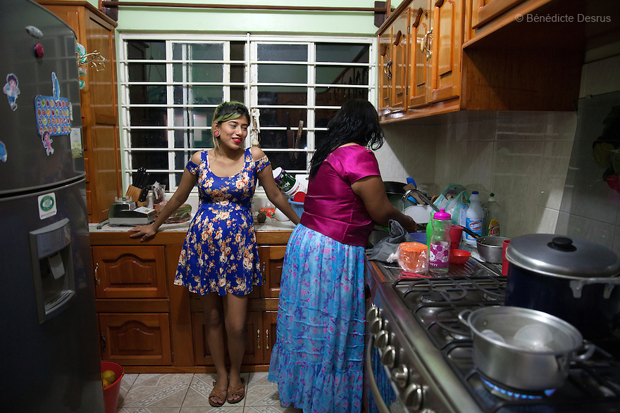 Xochiquetzal Sánchez Escobar and her mother Concepción Escobar Gómez, at their home in Juchitán, Mexico on February 17, 2016. Despite her teenage rebel style, Xochi, as she is known, dressed in the traditional Zapotec style for her engagement party. She is 17 and five months pregnant. The daughter of a single-mother former missionary and nun, Xochi says she had always talked about having a baby in her teens because she thought her mother was old when she had her at 28. She kept her pregnancy secret from her mother until February. After the baby - a boy, David Mateo - is born in June, she plans to move with her boyfriend to a house where they will live together and he will have his tattoo studio, and they plan to marry next June. She plans to finish her final year of secondary school in the town of El Espinal in the southern Mexican state of Oaxaca next year, with her mother looking after the baby in the mornings while she is in class. Being a schoolgirl housewife does not worry her, she says, although she admits she cannot cook. Her grandmother, who lives with the family, is thrilled at the prospect of a great-grandchild. Xochi dreams of giving birth in water, but is not sure that will happen. While Mexico has outlawed marriage under the age of 18, many young girls become unofficial wives and mothers much earlier. In Juchitán, teenage pregnancy is expected, even prized. Mexico ranks first in teenage pregnancies among the member countries of the Organization for Economic Co-operation and Development (OECD). Photo by Bénédicte Desrus