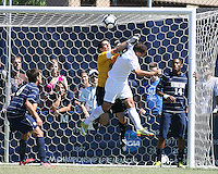 Matthew Brutto #1 of Georgetown University punches the ball away from Rubin Bega #9 of Michigan State during an NCAA match at North Kehoe Field, Georgetown University on September 5 2010 in Washington D.C. Georgetown won 4-0.