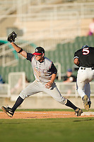 Asheville first baseman Michael Paulk (24) stretches for a throw versus Kannapolis at Fieldcrest Cannon Stadium in Kannapolis, NC, Sunday, April 29, 2007.