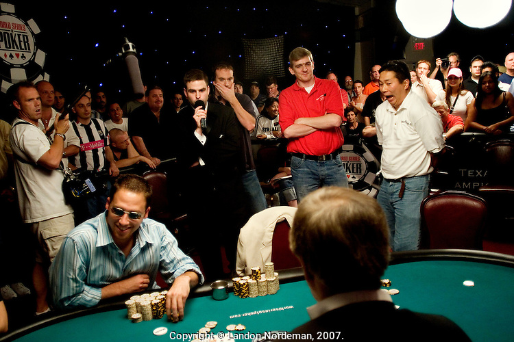 Bernard Lee, right, from Wayland, MA, reacts as he waits for the flop as he plays against Aaron Kanter, left, in sunglasses,  during the 36th annual World Series of Poker at Binion's Gambling Hall & Hotel on July 14, 2005 in Las Vegas, Nevada. Lee finished 13th and won $400,000. Kanter finished 4th and won $2 million. (Photo by Landon Nordeman)