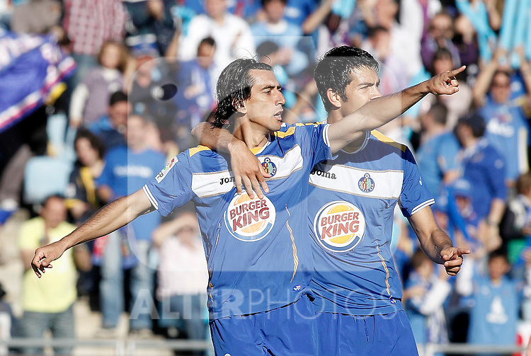 Getafe's Pedro Rios celebrates with Miku during La Liga Match. May 07, 2011. (ALTERPHOTOS/Alvaro Hernandez)