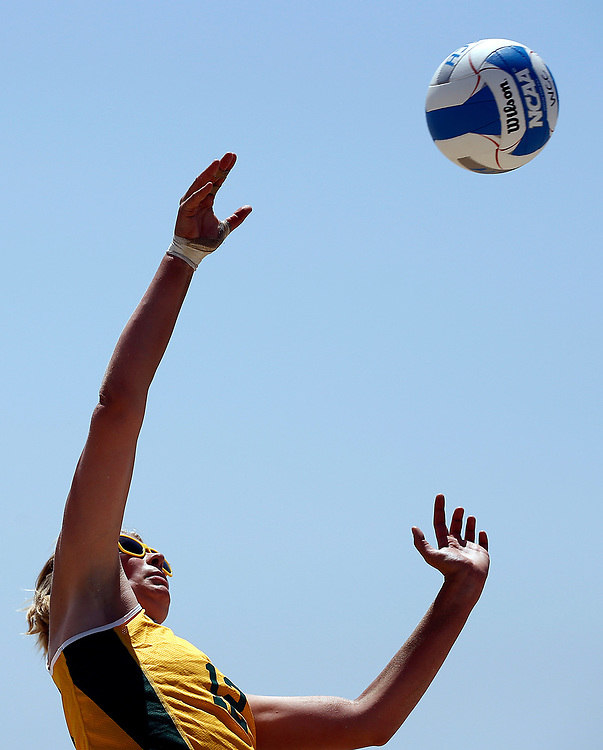 San Francisco's Marjolijn Oskam hits a shot against Santa Clara during the West Coast Conference beach volleyball Championship in Santa Monica, Friday, April 21, 2017.