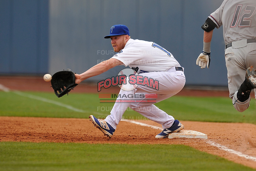Tulsa Drillers Paul Hoenecke (14) stretches for throws at first base during the game against the Northwest Arkansas Naturals at Oneok Field on May 2, 2016 in Tulsa, Oklahoma.  Northwest Arkansas won 9-6.  (Dennis Hubbard/Four Seam Images)