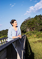 Woman enjoys the salt marsh viw from a foot bridge, Eastham, Cape Cod, Massachusetts, , USA