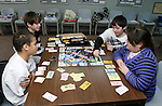 THOMASTON, CT, 01/03/08- 010309BZ01- Clocwise from left- Jeffrey Thompson, 10, Steven Schriver, 13, David Schriver, 10, and Marisa Santopietro (CQ), 9, play Star Wars Monopoly during &quot;Game Day&quot; at the Thomaston Public Library Saturday.  Kids were welcome to bring their own games or use those at the library owns in an effort to expand programming for children of all ages.<br />  Jamison C. Bazinet Republican-American
