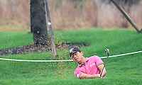 Wu Ashun (CHN) chips onto the 9th green during Thursday's Round 1 of the 2014 BMW Masters held at Lake Malaren, Shanghai, China 30th October 2014.<br /> Picture: Eoin Clarke www.golffile.ie