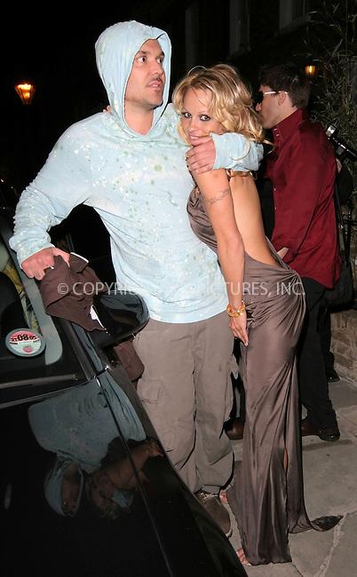WWW.ACEPIXS.COM . . . . .  ... . . . . US SALES ONLY . . . . .....LONDON, APRIL 20, 2005....Pamela Anderson and David LaChapelle at the 'Vegas Supernova' at Selfridges launch party.....Please byline: FAMOUS-ACE PICTURES-M. GILLIAM... . . . .  ....Ace Pictures, Inc:  ..Craig Ashby (212) 243-8787..e-mail: picturedesk@acepixs.com..web: http://www.acepixs.com