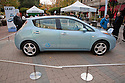Full length view of Nissan Leaf Zero electric car. Nissan Leaf Zero Emission Tour promotional event for the Nissan Leaf electric car that is scheduled to be released in Fall 2010. Car specs from Nissan: 5 person capacity, 90 MPH top speed, lithium-ion battery, 100 mile average range per charge. Santana Row, San Jose, California, USA, 12/5/09