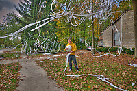 Westerville North senior Zach Philibin collects the toilet paper strewn across his family's front yard as a prank by other students at the school. Zach rolled the tissue into a giant ball to be kept in the freezer as part of a retaliation prank he's planning for later in the school year.