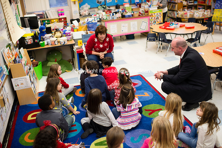 WOLCOTT, CT- 18 December 2015-121815EC03-  Dr. Tony Gasper, the new superintendent of Wolcott schools, listens in while Jane Gargano instructs her kindergarten class. Friday he visited several classrooms at Alcott Elementary School. Erin Covey Republican-American