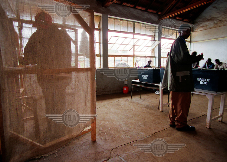 Voters in a Nairobi polling station. Mwai Kibaki won a landslide victory, seeing off his Kanu rival Uhuru Kenyatta. The poll marked the end of Daniel arap Moi's 24-year rule and the Kanu party's four decades in power.