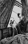 PZ 198, the 'Aaltje Adriaantje'.<br /> John Joll, first mate. <br /> <br /> He is now the skipper of his own trawler and working out of Plymouth.<br /> <br /> These boats are out for seven days at a time in all weathers and the nets are hauled up every three hours around the clock. The crew consists of five self-employed fishermen who share the profits of the catch.