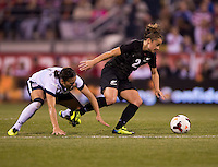Ali Krieger (11) of the USWNT fights for the ball with Ria Percival (2) of New Zealand during an international friendly at Crew Stadium in Columbus, OH. The USWNT tied New Zealand, 1-1.