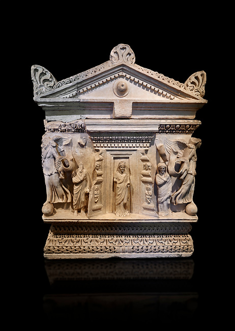 End panel of a Roman relief garland  sculpted sarcophagus, style typical of Pamphylia, 3rd Century AD, Konya Archaeological Museum, Turkey. Against a black background