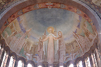Saint Genevieve (Sainte Geneviève), protecting Paris and France, monumental fresco of the Northern transept, painted by Leon Toublanc, 20th century, Nanterre Cathedral (Cathédrale Sainte-Geneviève-et-Saint-Maurice de Nanterre), 1924 - 1937, by architects Georges Pradelle and Yves-Marie Froidevaux, Nanterre, Hauts-de-Seine, France. Picture by Manuel Cohen