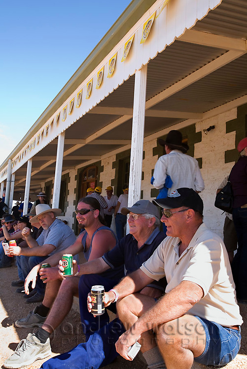 The historic Birdsville Hotel during the annual Birdsville races.  Every September the remote town of Birdsville hosts thousands of visitors for the Birdsville Cup, the most famous horse racing carnival in outback Australia.  Birdsville, Queensland, AUSTRALIA.