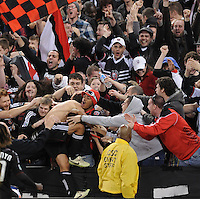 DC United forward Josh Wolff (16) celebrates his goal with fans.   DC United defeated The Columbus Crew 3-1  at the home season opener, at RFK Stadium, Saturday March 19, 2011.