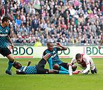 Nederland, Amsterdam, 25 maart 2012.Eredivisie .Seizoen 2011-2012.Ajax-PSV.Atiba Hutchinson (3van l.) van PSV brengt Ismail Aissati  (r.) van Ajax ten val in het strafschopgebied en veroorzaakt een strafschop