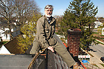 Jim Peppler on roof of his home in Freeport on April 25, 2003. Photo by a hired roofer.