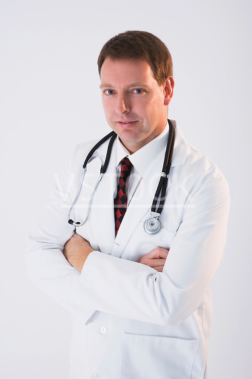 Male doctor with stethoscope, portrait