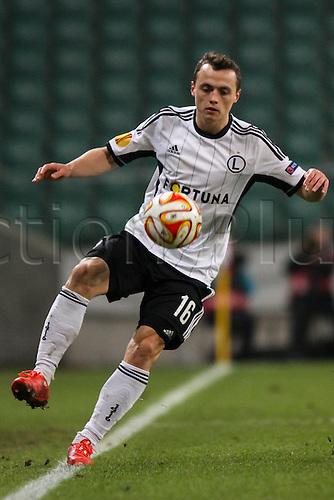 26.02.2015. Warsaw, Poland. Europa League football. Legia Warsaw versus Ajax.  Michal Maslowski (Legia)