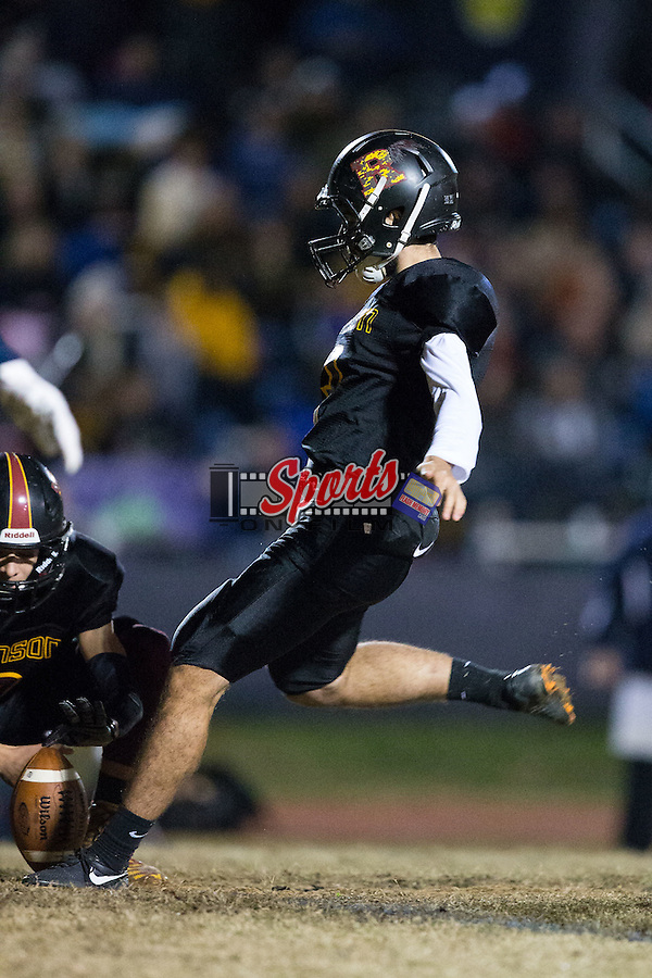 Joseph Bruner (3) of the JM Robinson Bulldogs kicks an extra point during first half action against the South Iredell Vikings at South Iredell High School November 20, 2015, in Statesville, North Carolina.  The Vikings defeated the Bulldogs 14-13.  (Brian Westerholt/Special to the Tribune)