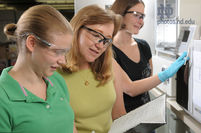 Joan Brennecke with grad students in her lab..Photo by Matt Cashore/University of Notre Dame