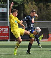 SCT MENEN - KSC DIKKELVENNE :<br /> Maxime Cottignie (L) en Koen Pouillon (R) strijden om de bal<br /> <br /> Foto VDB / Bart Vandenbroucke