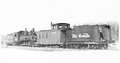 RGS 2-8-0 #42 with caboose #0404 and tender from D&amp;RGW #452 stored for the winter at Grady.<br /> RGS  Grady, CO  Taken by Kindig, Richard H. - 2/17/1953