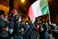 Manifestanti festeggiano le dimissioni del Presidente del Consiglio Silvio Berlusconi, davanti a Palazzo Grazioli, Roma, 12 novembre 2011..People wave an Italian tricolour flag to celebrate outside the residence of the Italian Premier Silvio Berlusconi, after he resigned, in Rome, 12 november 2011..UPDATE IMAGES PRESS/Riccardo De Luca