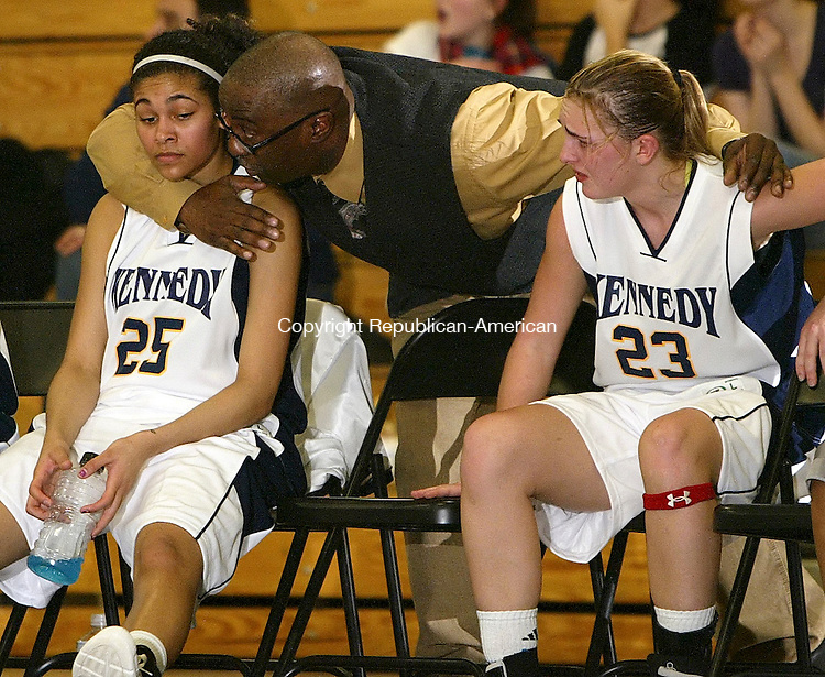 WATERBURY, CT, 01/09/08- 010909BZ16-  Kennedy assistant coach Ernest Blue consoles Jaleesa Roy (25) and Amber Alberto (23) in the final seconds of their 55-49 loss to Torrington Friday night. <br />  Jamison C. Bazinet Republican-American