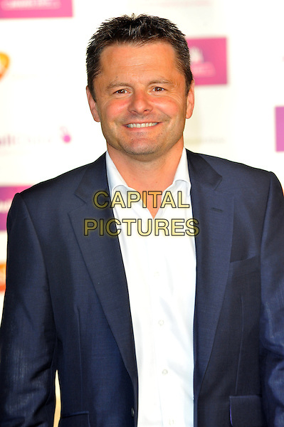 Chris Hollins.WellChild Awards held at the InterContinental Hotel, Park Lane, London, England..September 3rd, 2012.half length blue suit jacket white shirt .CAP/CJ.©Chris Joseph/Capital Pictures.