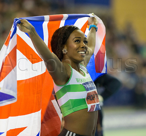 28.02.2016. EIS Sheffield, Sheffield, England. British Indoor Athletics Championships Day Two. Tiffany Porter (Woodford G) looks up to the scoreboard and holds up a Union Jack after winning the 60m Hurdles British Title.