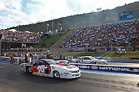 Jul. 19, 2013; Morrison, CO, USA: NHRA pro stock driver Mike Edwards (near) races alongside Allen Johnson during qualifying for the Mile High Nationals at Bandimere Speedway. Mandatory Credit: Mark J. Rebilas-