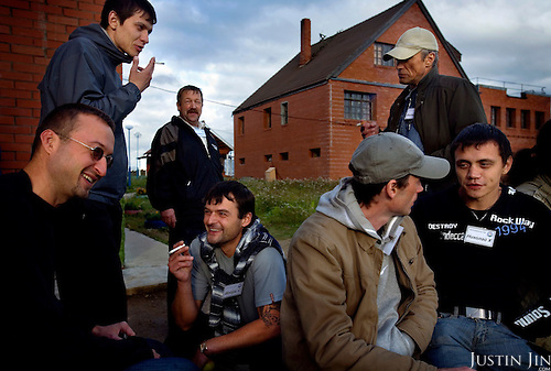 """Recovering alcoholics smoke during a break at the """"House of Hope on a Hill"""" in a village outside St. Petersburg, Russia, where they attend a 28-day therapy..The centre, started by American Lou Bantle, treats alcoholics from all over Russia for free. .Alcoholism is a main cause of death in Russia."""