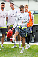 Melbourne, 17 July 2015 - Lucas Vázquez of Real Madrid kicks an Aussie Rules football after a training session at the Melbourne Cricket Ground ahead of their International Champions Cup match against AS Roma tomorrow in Melbourne, Australia. Photo Sydney Low/AsteriskImages.com