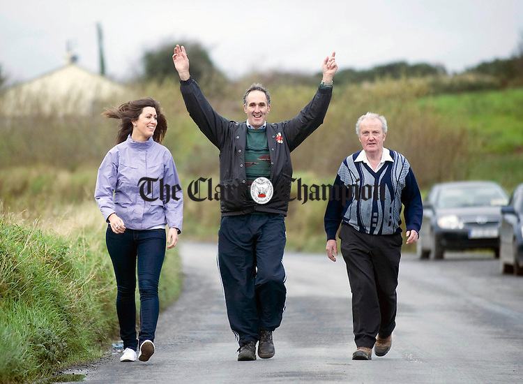 John Griffin, centre, with Pauline Griffin and Patrick Moloney taking part in the annual Meitheal Walk in Kilmaley at the weekend. Photograph by Declan Monaghan