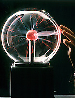 PLASMA LAMP<br /> Point Discharge Caused By Touching Lamp  Surface<br /> Plasma consists of a mixture of neutral particles, positive ions, and negative electrons. A plasma is a conductor of electricity