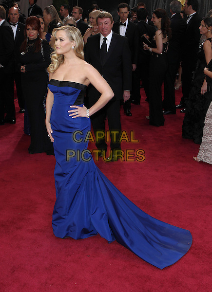 Reese Witherspoon (wearing Louis Vuitton).85th Annual Academy Awards held at the Dolby Theatre at Hollywood & Highland Center, Hollywood, California, USA..February 24th, 2013.oscars full length dress hand on hip black strapless  cobalt blue train .CAP/ADM/SLP/COL.©Colin/StarlitePics/AdMedia/Capital Pictures