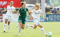 Manya Makoski (white) goes past Kerri Hanks..Saint Louis Athletica and LA Sol, played to a 0-0 tie at Robert Hermann Stadium in St Louis, MO. April 25 2009.