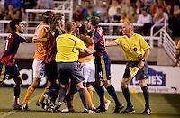 An altercation between Real Salt Lake Defender Chris Wingert (center) and Houston Dynamo Midfielders Corey Ashe and Dwayne De Rosario in the 0-0 draw between Real Salt Lake and the Houston Dynamo on July 3, 2008 at Rice-Eccles Stadium in Salt Lake City, Utah.