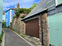 BNPS.co.uk (01202 558833)<br /> Pic: TheCoastalHouse/BNPS<br /> <br /> Garage.<br /> <br /> A stunning waterfront home with breathtaking views over an idyllic estuary has emerged for sale for £1.5m.<br /> <br /> Tower House in Kingswear, Devon, overlooks a charming corner of the River Dart which is home to a number of exclusive sailing boats.<br /> <br /> The water is surrounded by several miles of jaw-dropping coastline with the owners able to enjoy the scenery from a wrap around balcony.<br /> <br /> Across the harbour is also the Britannia Royal Naval College at Dartmouth.