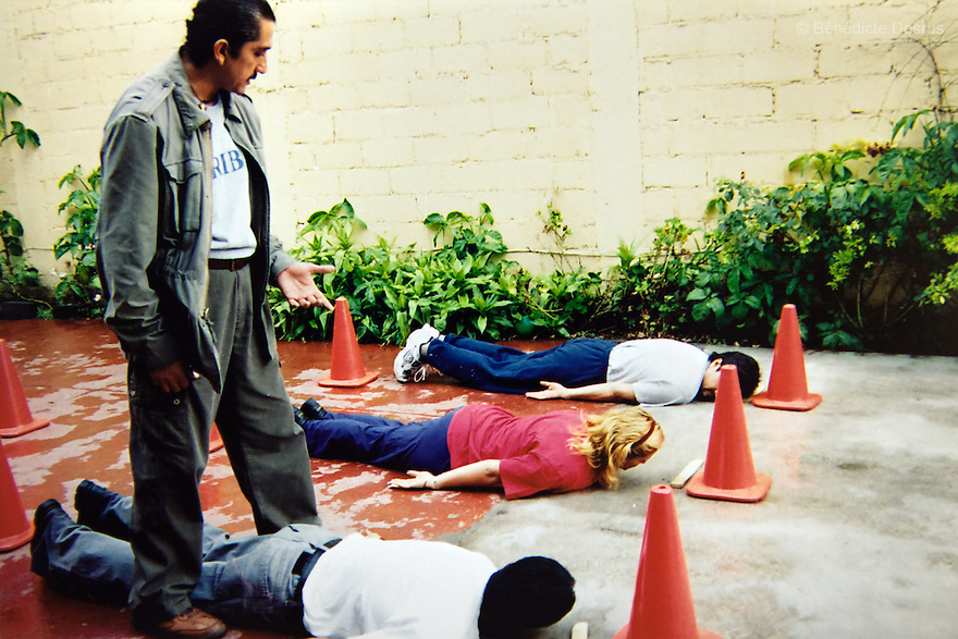"""An old photograph of Donovan teaching a self-defense class in Iztapalapa, Mexico in 2004. Donovan Tavera, 43, is the director of """"Limpieza Forense México"""", the country's first and so far the only government-accredited forensic cleaning company. Since 2000, Tavera, a self-taught forensic technician, and his family have offered services to clean up homicides, unattended death, suicides, the homes of compulsive hoarders and houses destroyed by fire or flooding. Despite rising violence that has left 70,000 people dead and 23,000 disappeared since 2006, Mexico has only one certified forensic cleaner. As a consequence, the biological hazards associated with crime scenes are going unchecked all around the country. Photo by Bénédicte Desrus"""